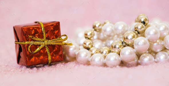 Birthday gift box and pearls for female - Stock Photo - Images