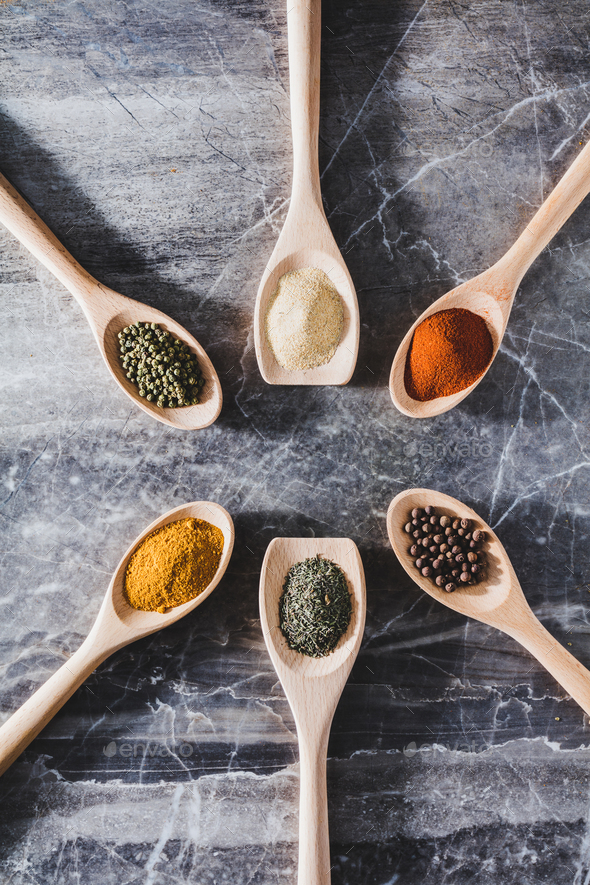 Six wooden spoons with different seasonings - Stock Photo - Images