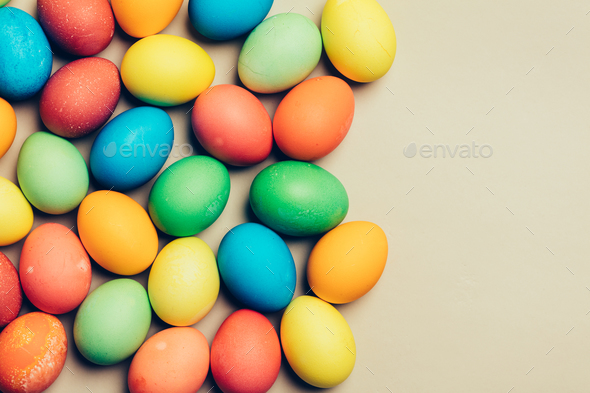 Couple of dyed eggs laying on a creamy background. - Stock Photo - Images