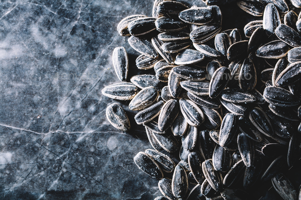 Black sunflower seeds on marble background - Stock Photo - Images