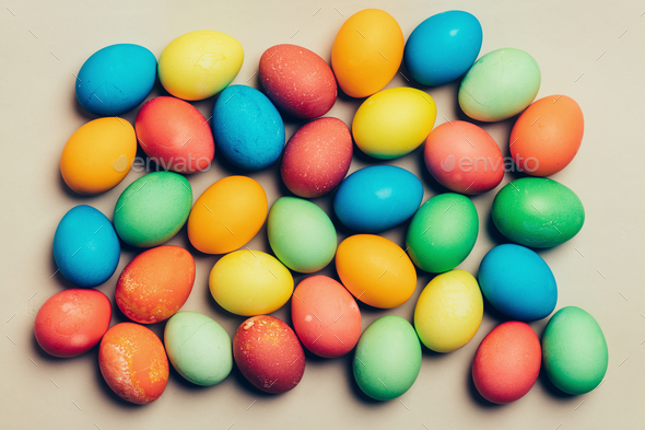 Colorful eggs on a creamy background. - Stock Photo - Images