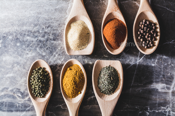 Six wooden spoons with colorful spices - Stock Photo - Images