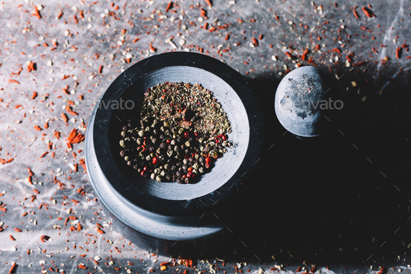 Mixed colorful grains of pepper in a mortar - Stock Photo - Images