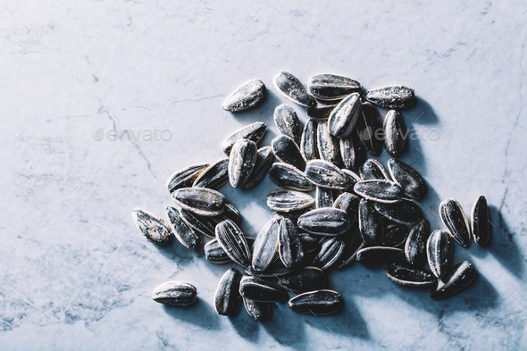 A few black sunflower seeds. Fit snack. - Stock Photo - Images