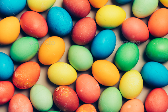 Multiple dyed eggs laying on the floor. - Stock Photo - Images