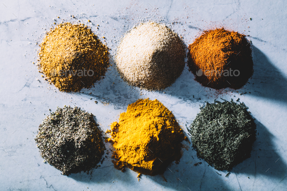 Six piles of colorful spices and herbs. - Stock Photo - Images