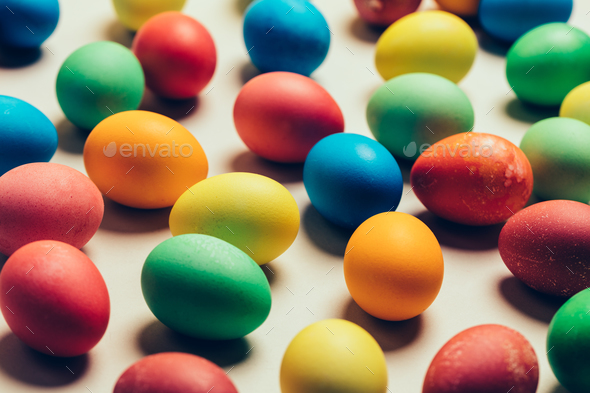 Bunch of colorful eggs laying on the ground. - Stock Photo - Images