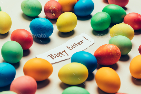 """""""Happy Easter"""" writing and bunch of colorful dyed eggs. - Stock Photo - Images"""