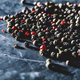 Grains of mixed pepper spilled on counter - PhotoDune Item for Sale