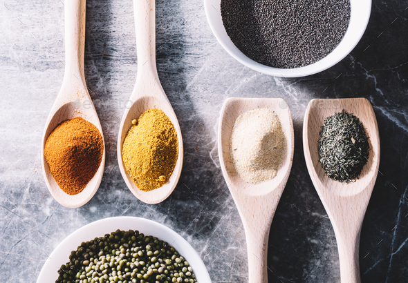 Spices on spoons, chia seeds and green beans in bowls. - Stock Photo - Images