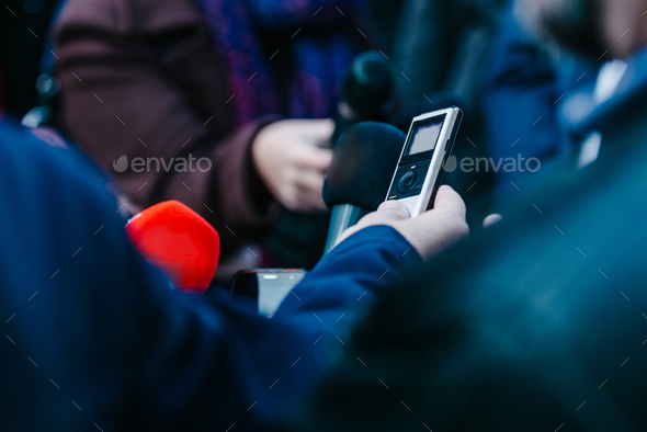 Interviewing businessman on press conference - Stock Photo - Images
