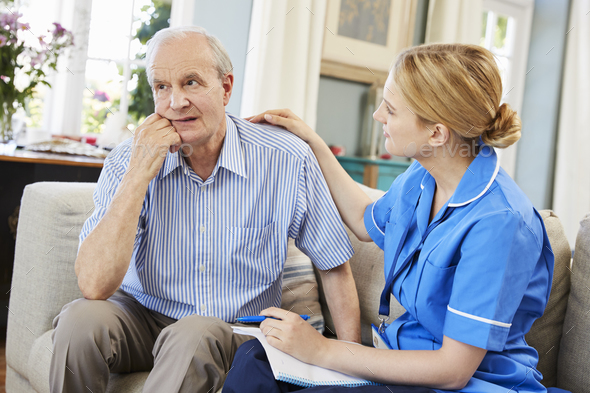 Community Nurse Visits Senior Man Suffering With Depression - Stock Photo - Images