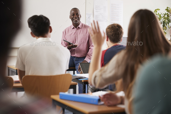 Rear View Of Female College Student Asking Question In Class - Stock Photo - Images