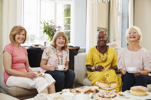 Portrait Of Senior Female Friends Enjoying Afternoon Tea At Home - Stock Photo - Images