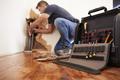 Middle aged man repairing burst pipe,plumbing, focus on foreground - PhotoDune Item for Sale