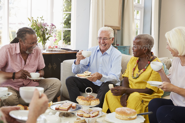 Group Of Senior Friends Enjoying Afternoon Tea At Home Together - Stock Photo - Images