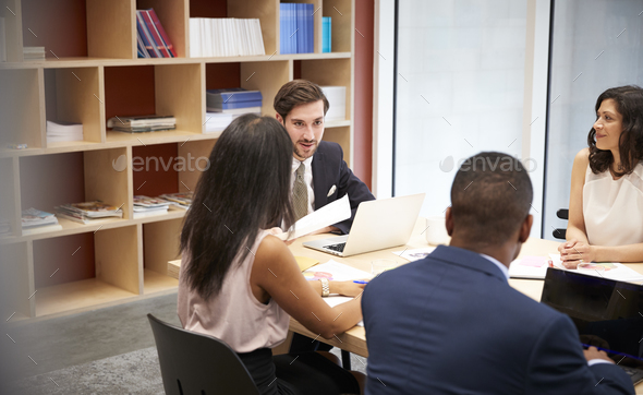 Four business people at a boardroom meeting - Stock Photo - Images