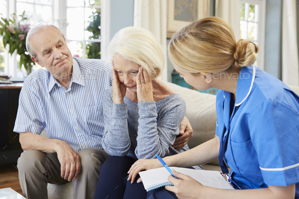 Community Nurse Visits Senior Woman Suffering With Depression - Stock Photo - Images