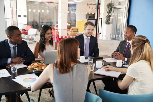 Business colleagues talking in a meeting room - Stock Photo - Images