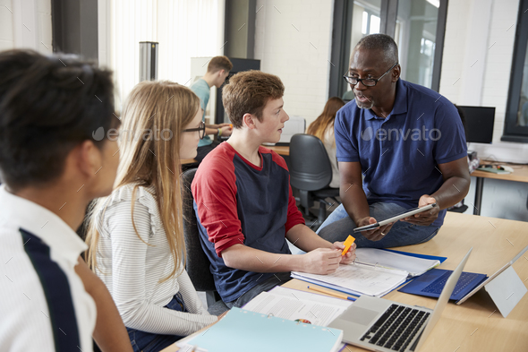 Design Students With Teacher Working In CAD/3D Printing Lab - Stock Photo - Images