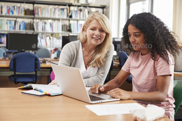 College Student Has Individual Tuition From Teacher In Library - Stock Photo - Images