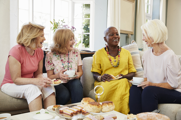 Senior Female Friends Enjoying Afternoon Tea At Home Together - Stock Photo - Images