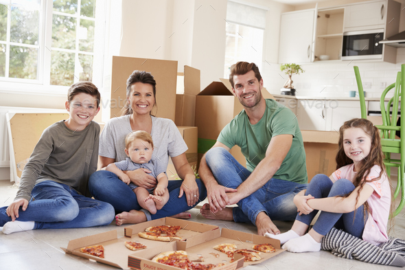 Portrait Of Family Celebrating Moving Into New Home With Pizza - Stock Photo - Images