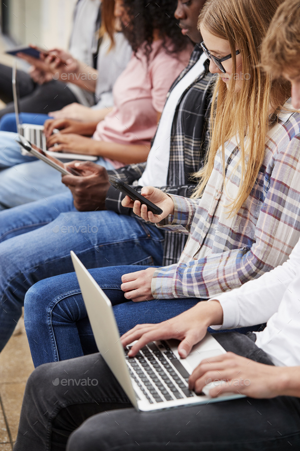 Close Up Of Seated College Students Using Digital Technology - Stock Photo - Images