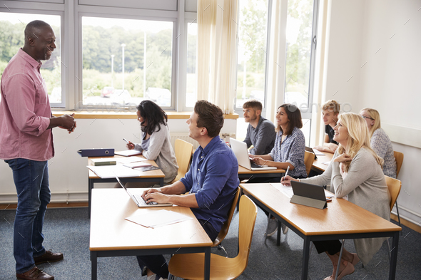 Male Tutor Teaching Class Of Mature Students - Stock Photo - Images