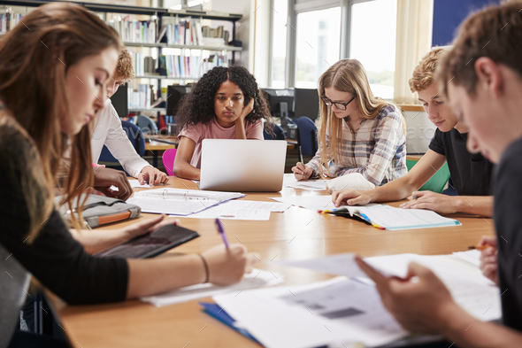 Group Of College Students Working Around Table In Library - Stock Photo - Images