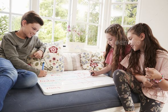 Children Making List Of Chores On Whiteboard At Home - Stock Photo - Images