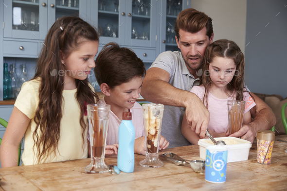 Father Making Ice Cream Sundaes With Children At Home - Stock Photo - Images