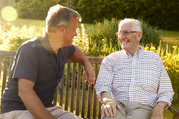 Man Visiting Senior Male Relative In Assisted Living Facility - Stock Photo - Images