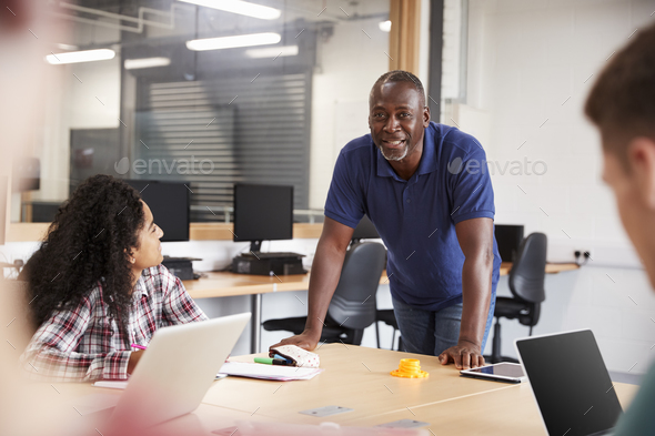 Teacher In Lesson For College Students Studying CAD/3D Design - Stock Photo - Images