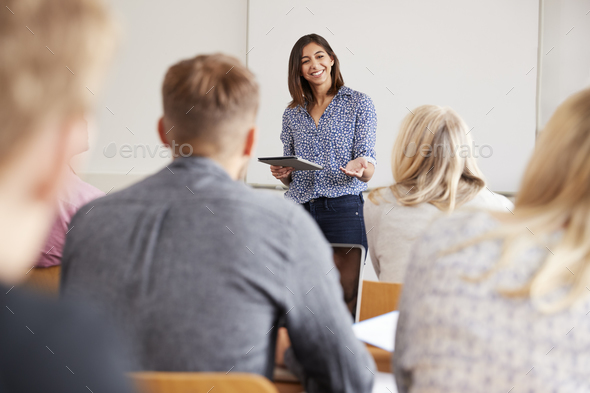 College Tutor With Digital Tablet Teaches Mature Students - Stock Photo - Images
