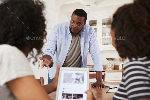 Father Discusses Online Safety With Teenage Daughters - Stock Photo - Images