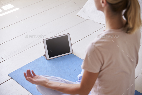 Woman With Digital Tablet Using Meditation App In Bedroom - Stock Photo - Images