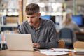 Mature Male Student Working On Laptop In College Library - PhotoDune Item for Sale