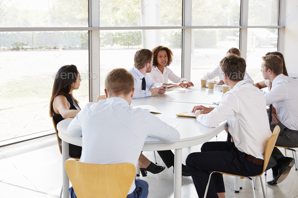 Young businesswoman chairing a business team meeting - Stock Photo - Images