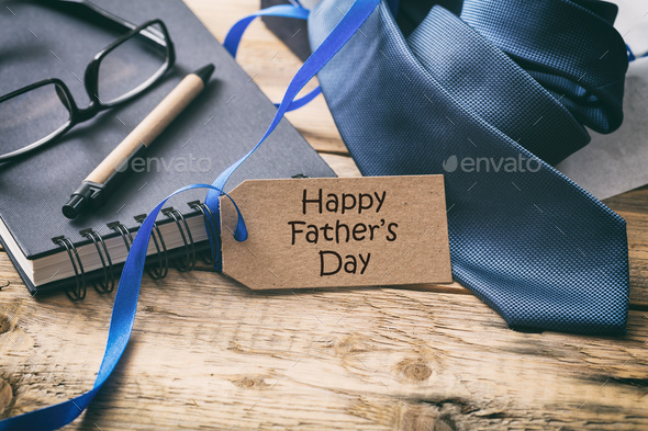 Happy Father's day. Blue tie and tag, office desk background, copy space - Stock Photo - Images