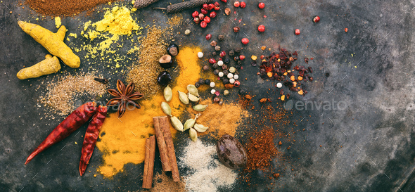 Variety of colorful spices on metal rusty background, top view, copy space, banner - Stock Photo - Images