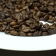 Camera Slides Above Coffee Beans on the White Plate. - VideoHive Item for Sale