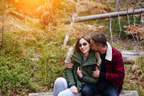 guy kisses his girlfriend in the forest - Stock Photo - Images