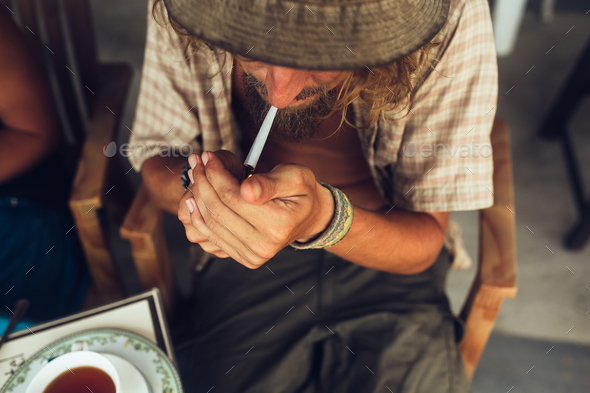 The guy smokes a cigarette - Stock Photo - Images