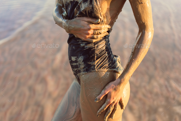Body in mud from a close angle - Stock Photo - Images