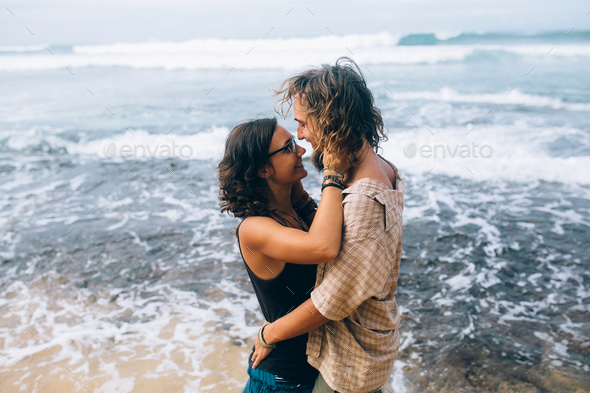 couple on a tropical beach - Stock Photo - Images