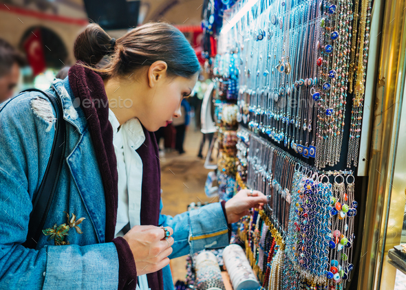 Young girl tourist walking in the souvenir market - Stock Photo - Images