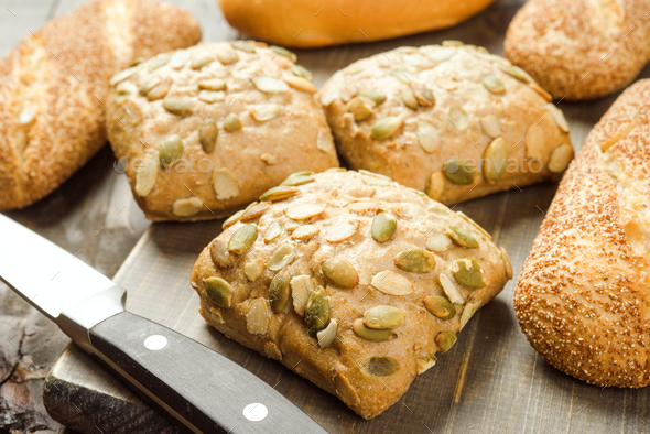 rustic bread baked with seeds - Stock Photo - Images