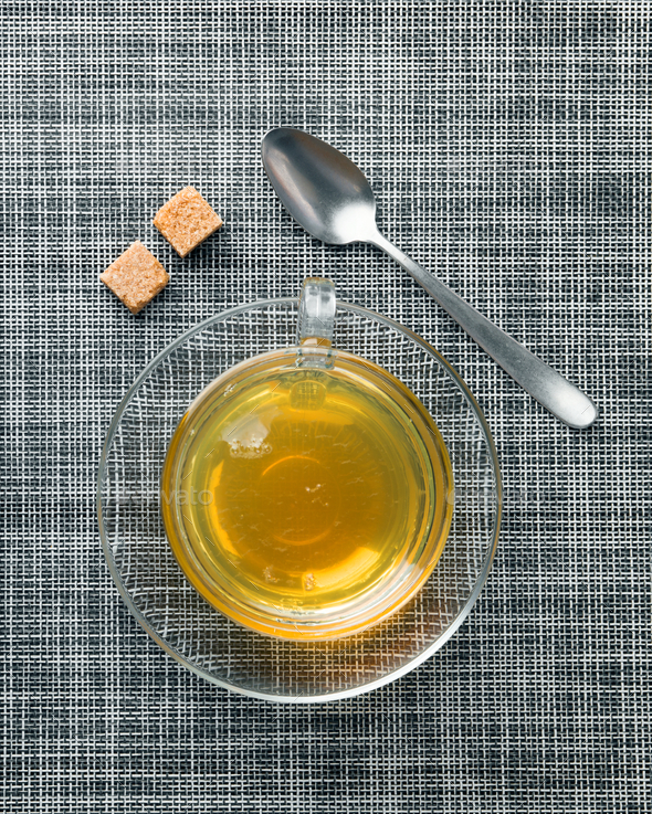 tea cup on mat - Stock Photo - Images