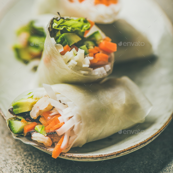 Shrimp and vegetable rice paper rolls on plate, square crop - Stock Photo - Images